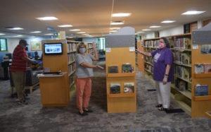 Library staff wear mask